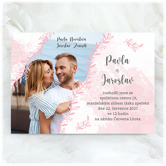 Wedding invitation with a photo of the engaged couple