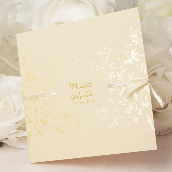 Opening elegant wedding invitation with cream shiny pearl ornaments