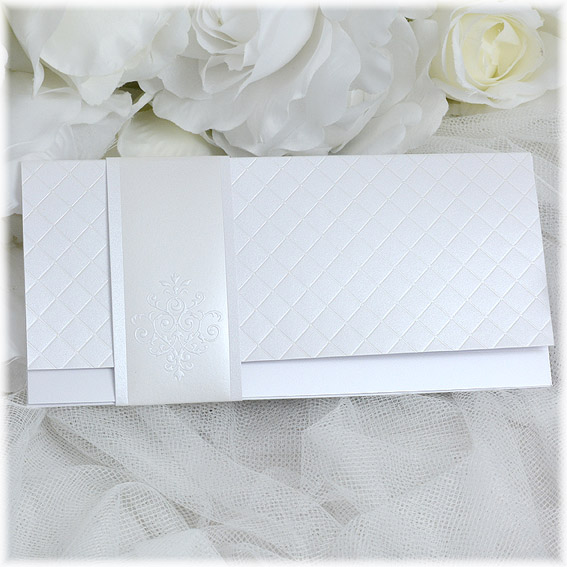 Wedding announcements with pearly embossing and jacket with ornament