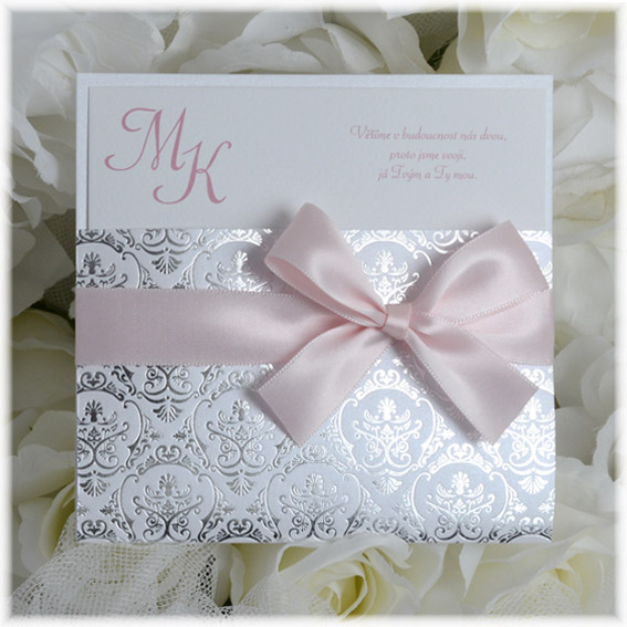 Luxury wedding invitation with pink ribbon and silver embossing