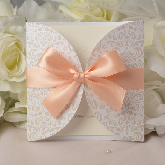 Exclusive wedding invitation with apricot ribbon