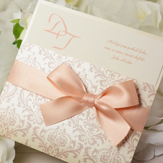 Luxury wedding invitation with apricot ribbon and ornament